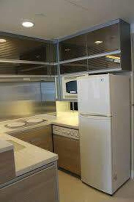 You could use our washing machine, refrigerator and the full kitchen.