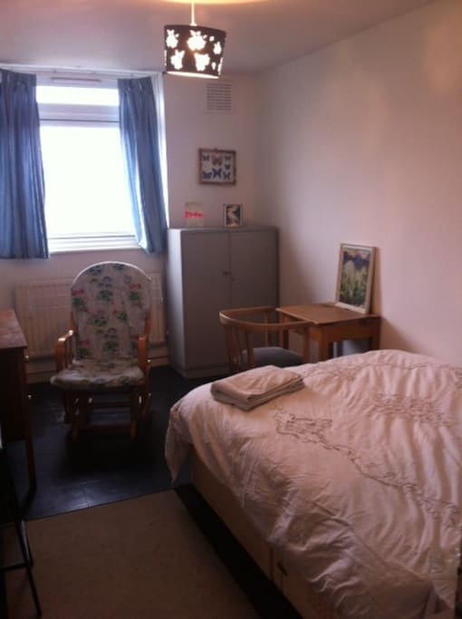 Double bedroom, Wardrobe, chest of drawers, shelving, desk and chair.