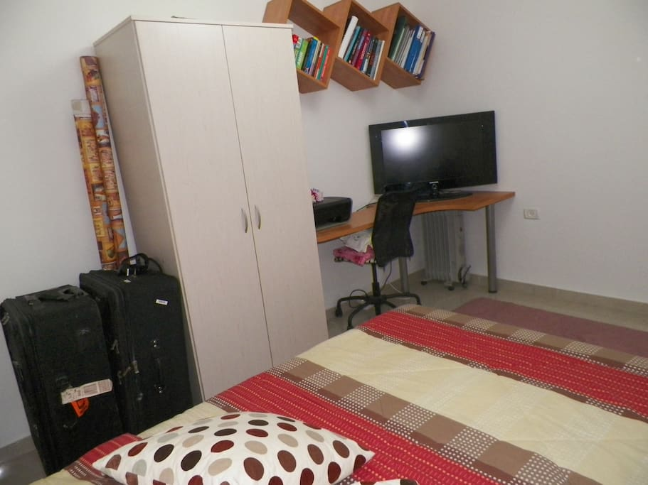You have a small area where you can place your luggage. Also there is a small heater for the winter.