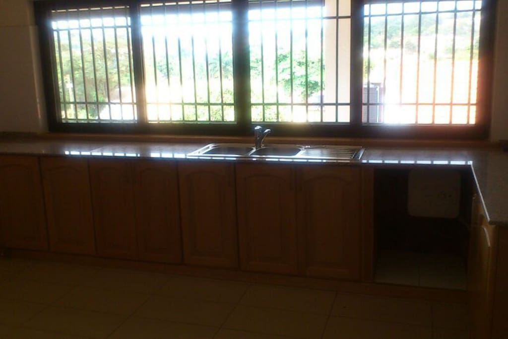 Very spacious kitchen with refrigerator and cooker