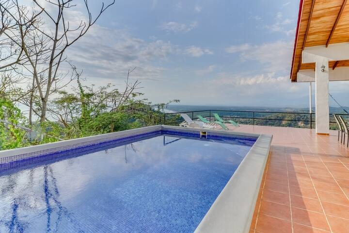 Hilltop home w/ pool, wrap-around deck & amazing ocean view - near beaches!