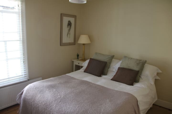 main bedroom, very light , with built in wardrobes, top quality sheets and linen .