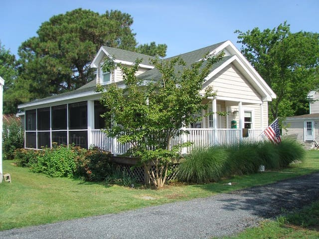 Front View with Screened porch overlooking harbor