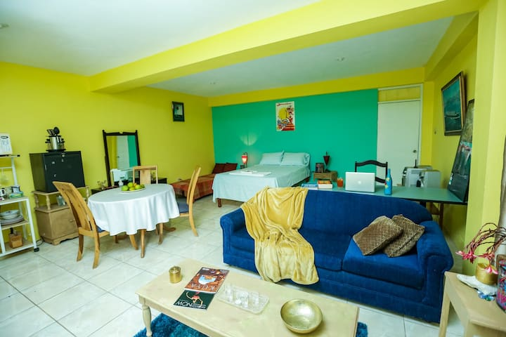 This is room 1 of the apartment and comes equipped with sofa, desk, double bed and day bed, dining table, refrigerator , coffee machine, convection cooktop and other amenities
