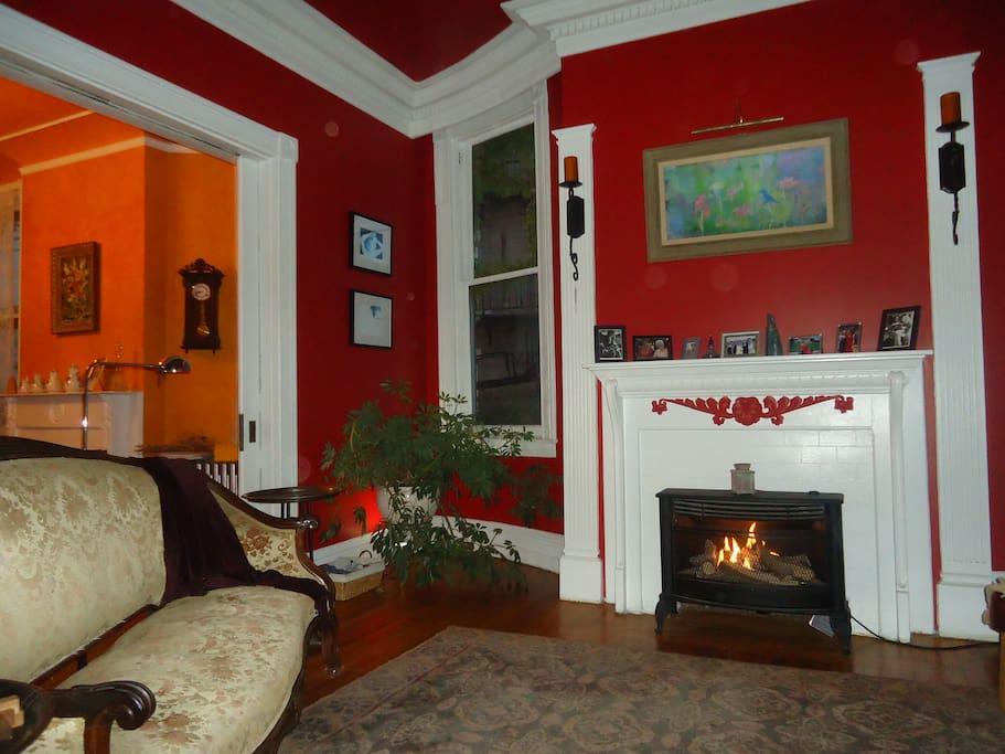 Main floor living room has gas burning fireplace