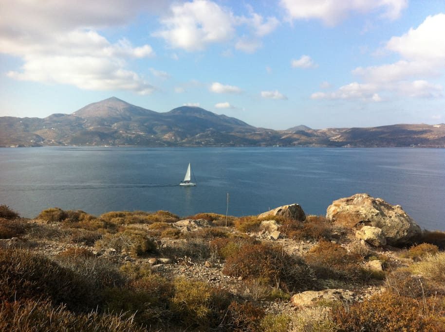 South view from the villa to the bay of Milos and the boats heading in and out of the port of Adamas.