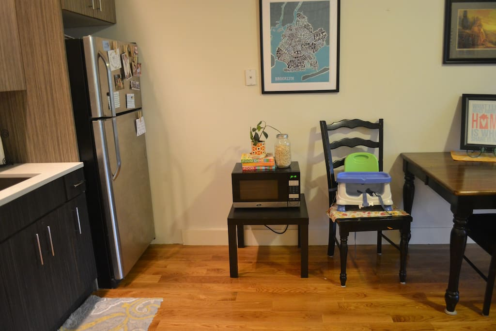 Microwave and dining table.