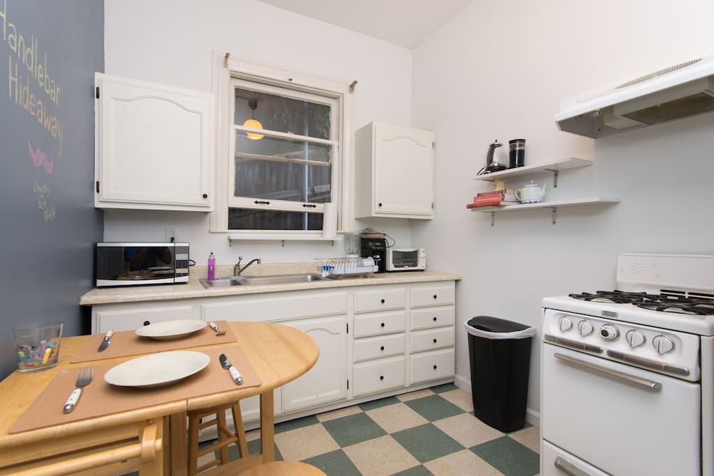 A fully equipped  eat-in kitchen has everything you need to make a gourmet meal or just store your beer and cereal.