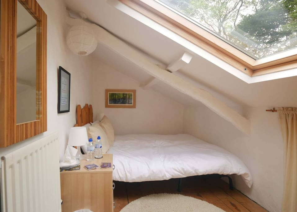 This double room is cosy (which means it is small) and full of light. Mind your head.