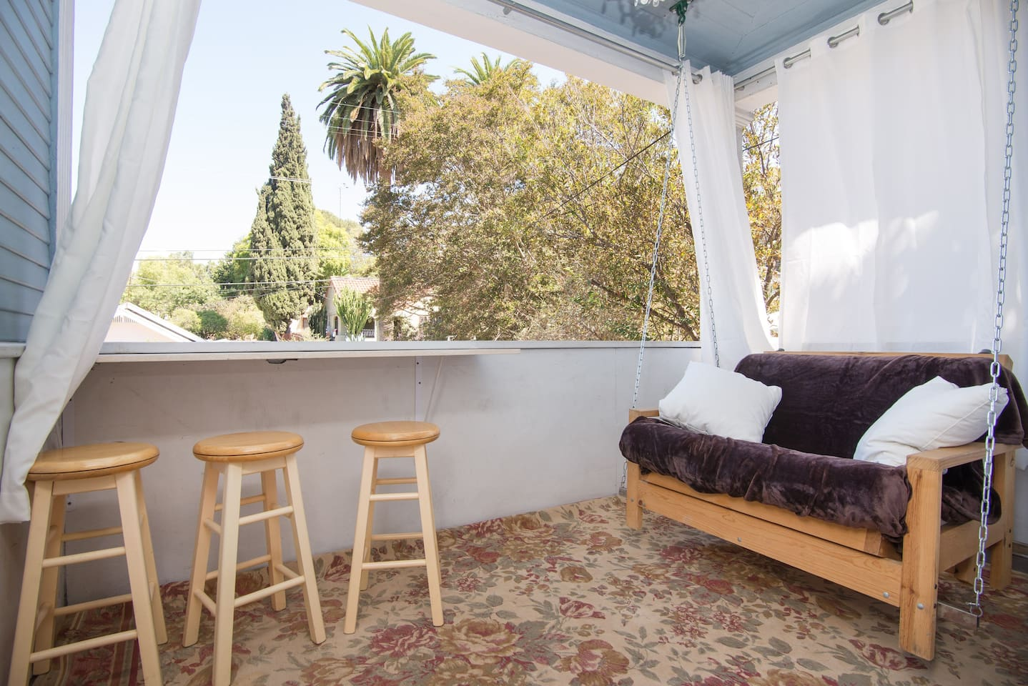 The private porch has a three seat bar to comfortably have a cup or coffee, enjoy a meal, set up a work station or simply watch the neighbors walk their dogs to the nearby park.