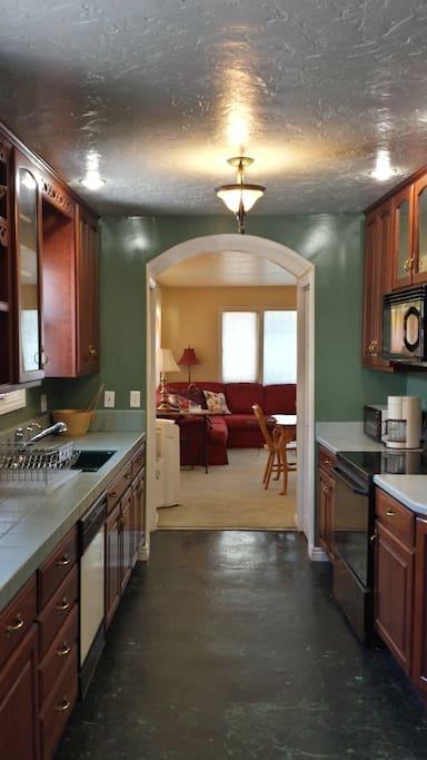 Arched opening leads from living area to 24-foot-long kitchen!