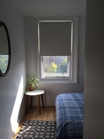 Bright double room in Victorian terraced house.