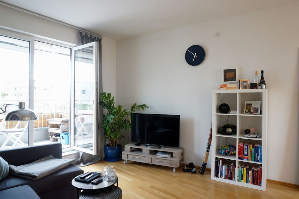 The living area has also a modern TV for the evening entertainment after a busy day in the city.