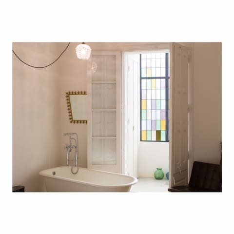 Master bedroom with functioning vintage bathtub