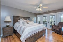 Master bedroom w/ king and french doors to screened porch