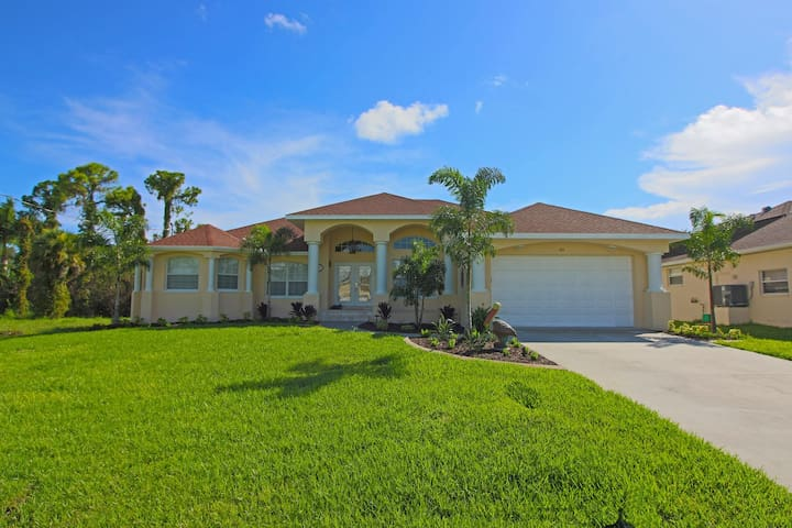 Luxurious 4 bedroom, with 2 master suites, 4 baths, heated pool and spa home located on a canal.