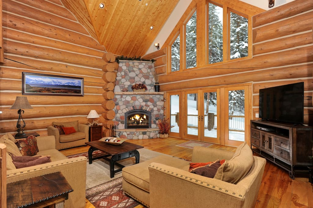 Featuring Gas Fireplace, Flat Screen TV and Doors out to Spacious Deck