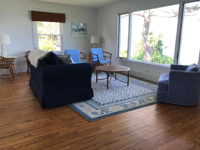 Main floor living room with phenomenal views of  House Island and Portland