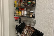 Need to spice up that dish, measure some ingredients, or handle hot oven food? Feel free to use any of the spices, measuring cups, and oven mits that are provided on the kitchen wall rack.