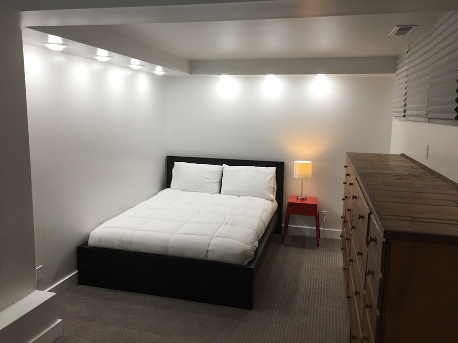 Cozy brand new queen bed with overhead dimmable  lighting and plenty of drawer space and bag space. Plenty of room for one of the twin sleepers on the floor as well.
