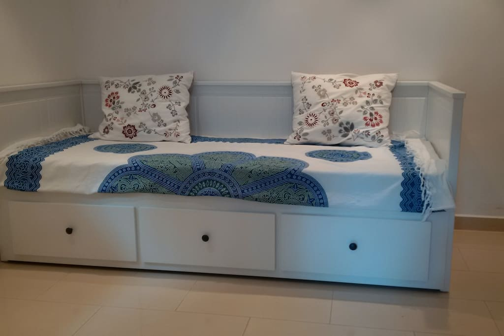 This brandnew bed can be used as a sofa during the day