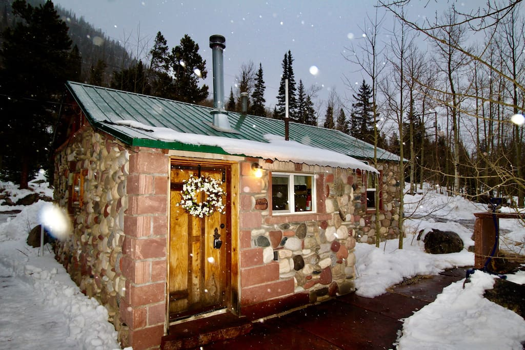Snow falling on the Stone Cabin.