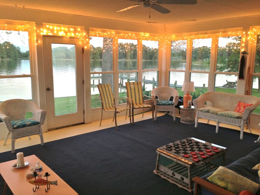 Waterfront porch faces dock, AC or breeze, seating for 14