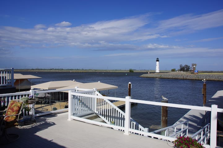 Waterfront House by Lighthouse Boat Docks