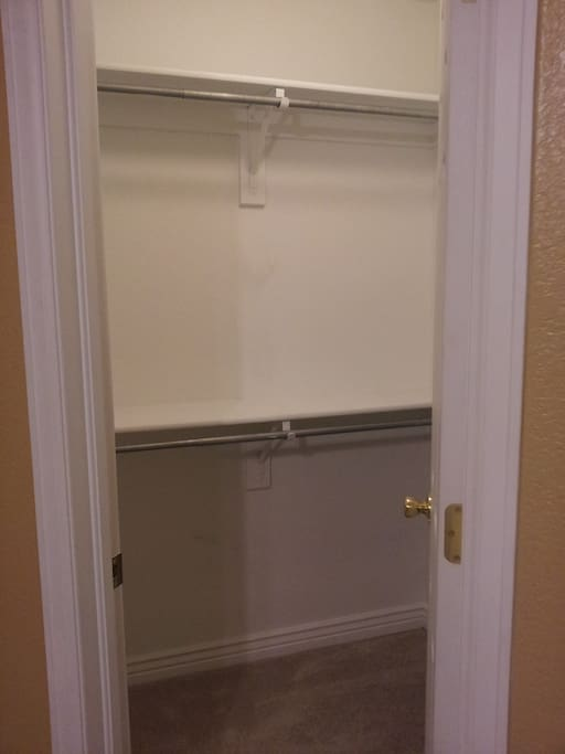 Walk-in closet with shelves and cubby spaces.