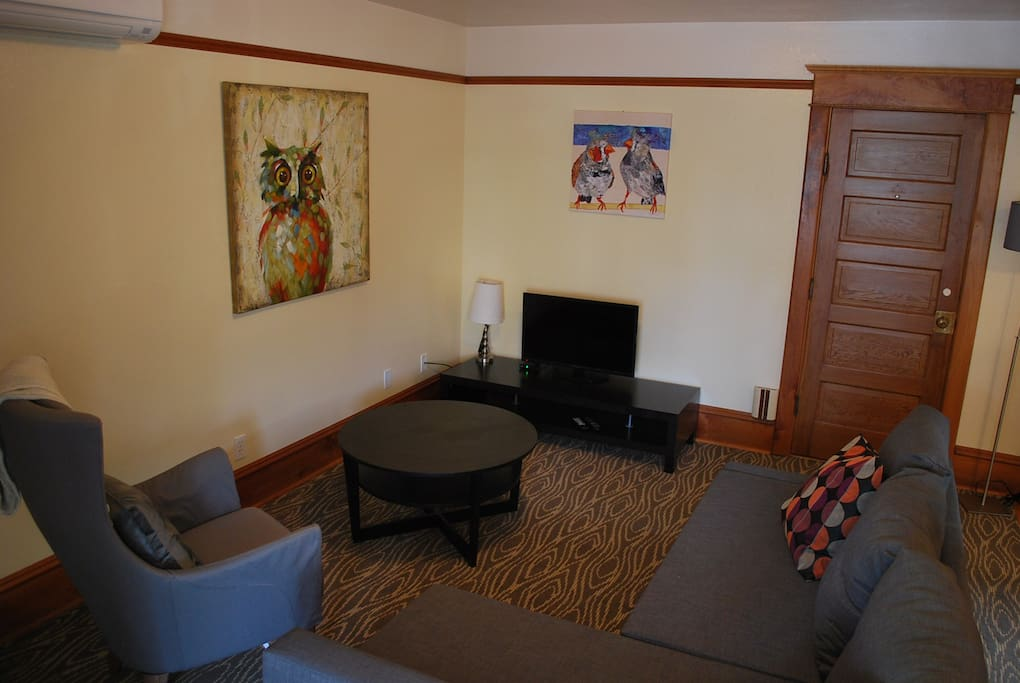 Living room with cable television and wireless internet.