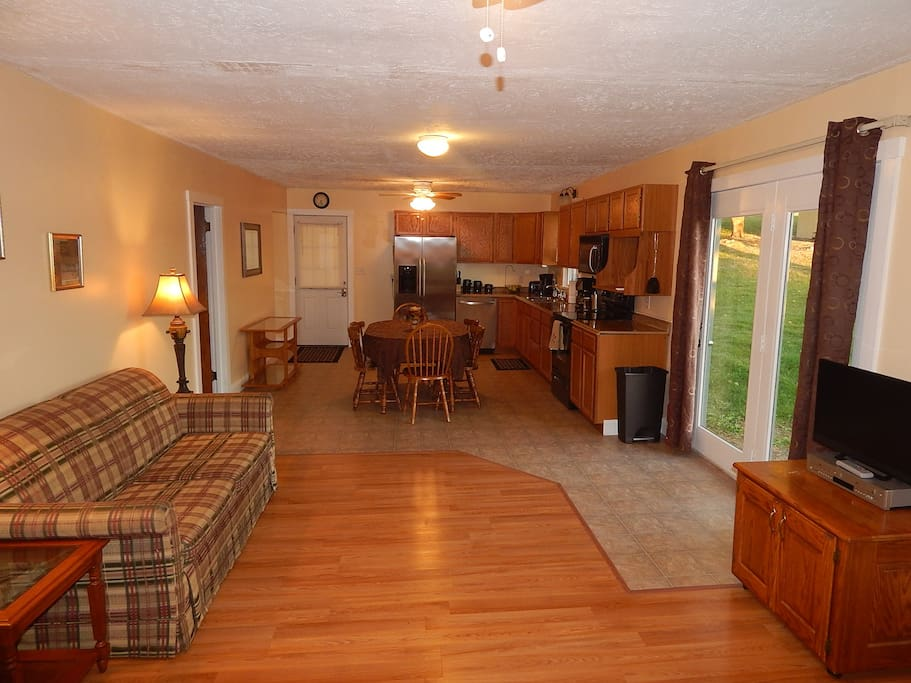Open kitchen, dining, & living room with dvd/vcr player