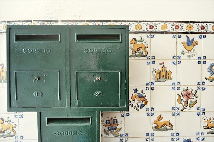 The old mailboxes in the building.