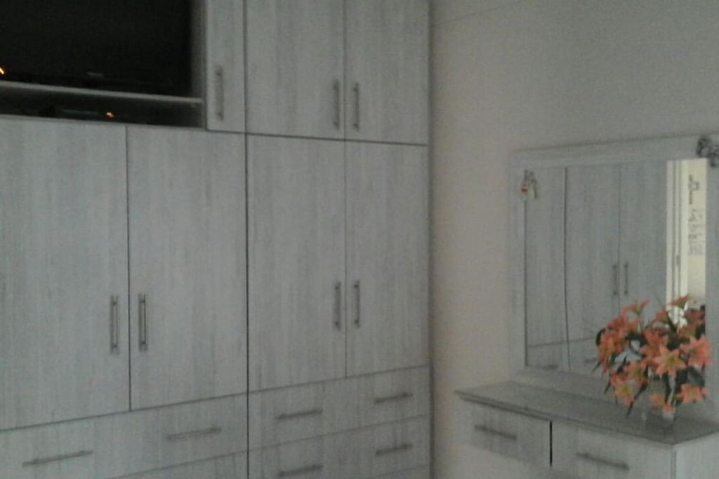 Main bedroom with 32 in tv and tv box. Netflex, Youtube and Google. Built in cupboards
