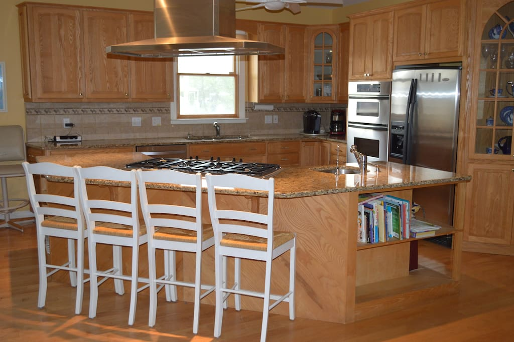 Large Gourmet Kitchen attached to 12  guest dining table area