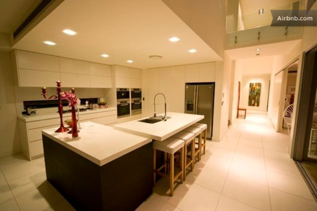 kitchen with automatic cappuccino machine, ice & water maker fridge and fully equipped cupboards
