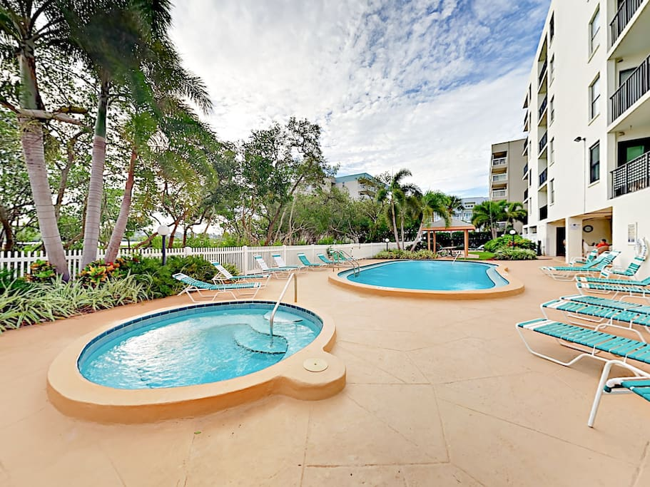 Soak up the Florida sun by the shared pool with hot tub and plenty of lounge space.