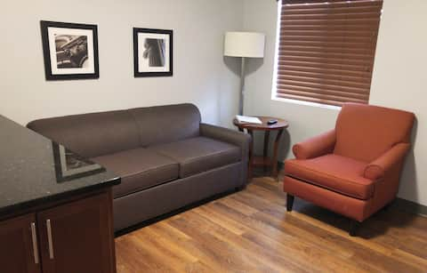 "Living room includes flat screen 40"" television, queen size pullout sofa sleeper and armchair"
