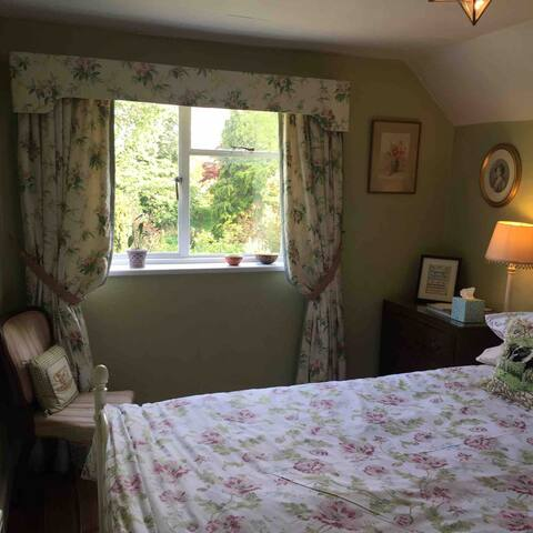 This shows the very pretty double room , number 3, which looks over the back garden and orchard.It is an extra long bed for our tall guests!
