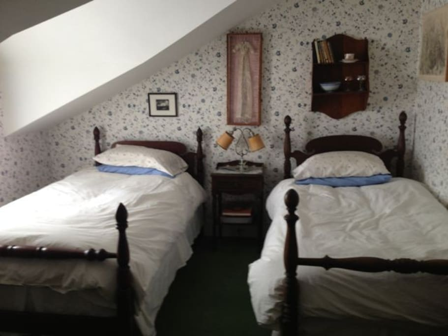 Twin bedroom with shared bath.