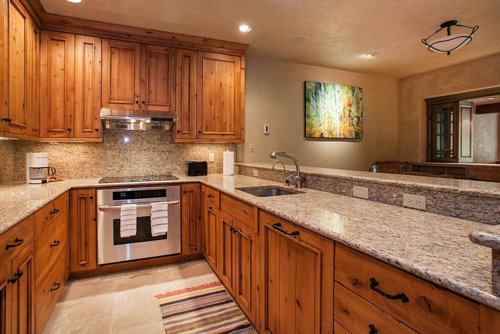 Fully equipped, spacious kitchen, granite countertops and stainless accents.