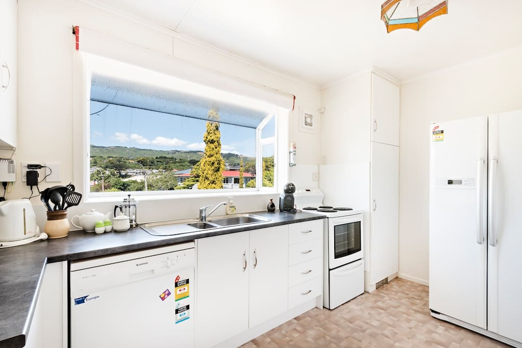 Huge kitchen with large french two door fridge/ freezer which will fit all your frozen and refrigerated food. Well equipped kitchen with everything needed.