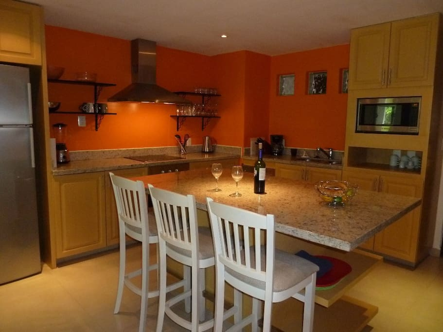 Fully equipped kitchen with fridge, stove, dishwasher, microwave and washer/dryer