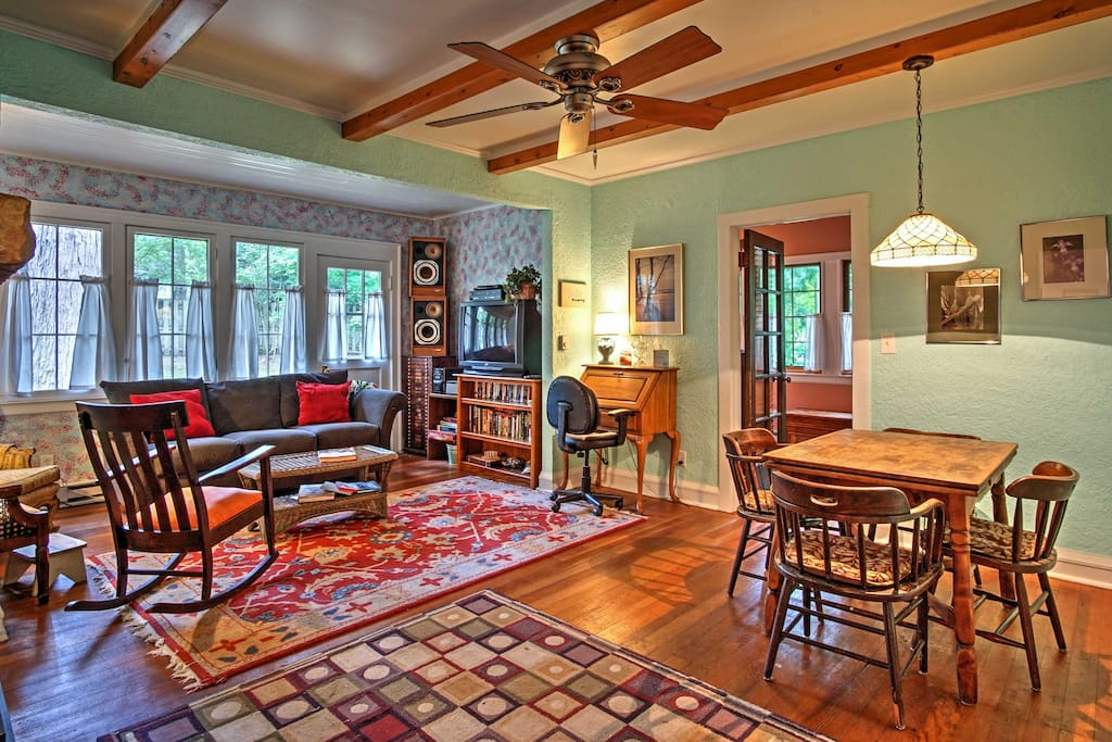 The 1,900 square feet of interior living space is adorned with hardwood floors, wood beams, traditional decor, and an abundance of windows.