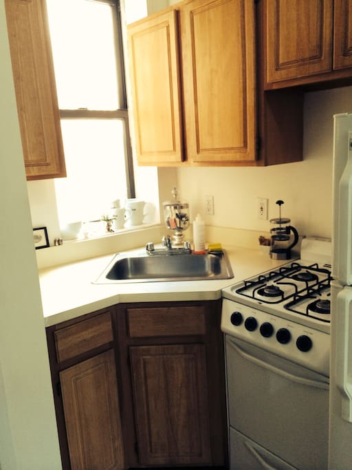 Kitchen nook, which is workable. Includes: Dishes, storage, stove and refrigerator.