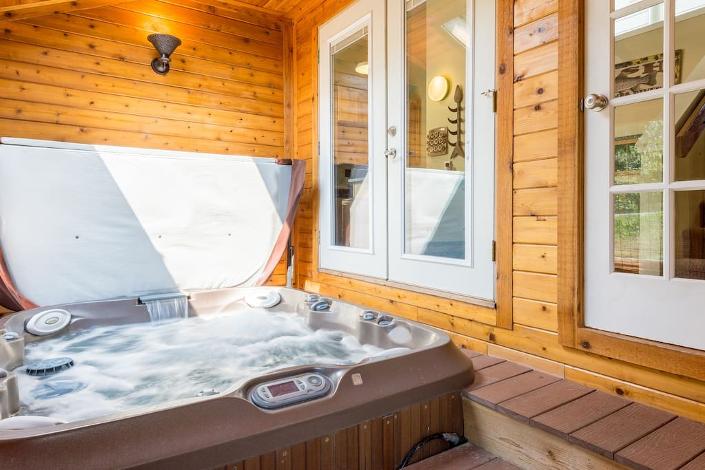 Relax in the hot tub on the back deck.