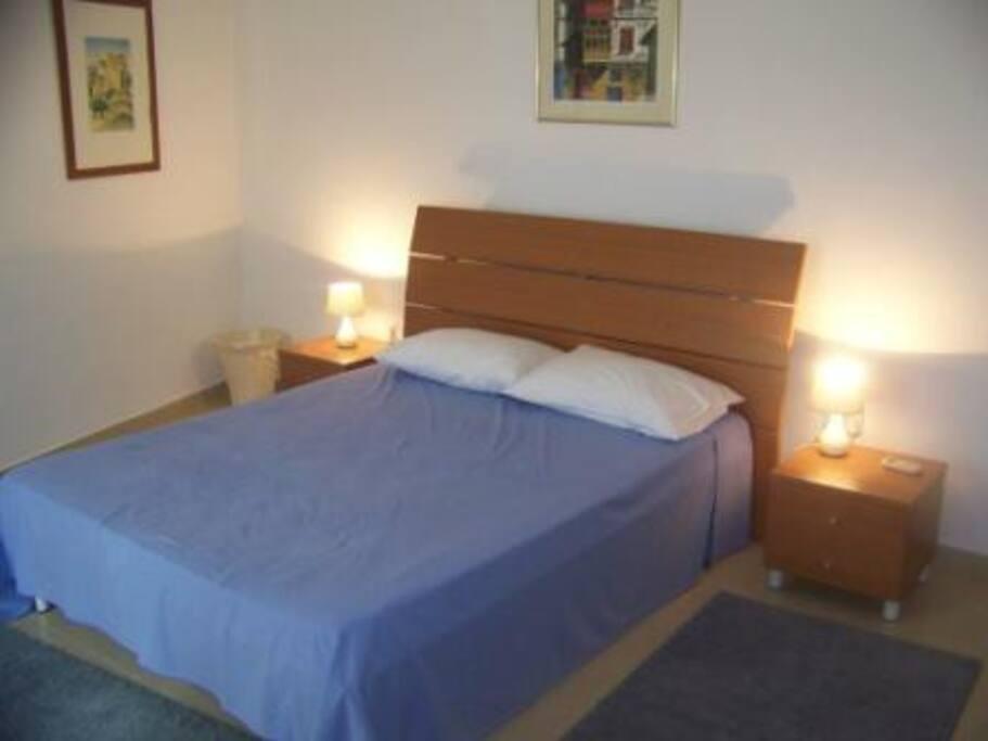 Main bedroom with  en suite shower/ toilet room.