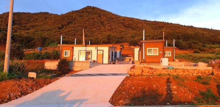 동그라미 하우스 - 바다가 보이는 언덕 위의 집
