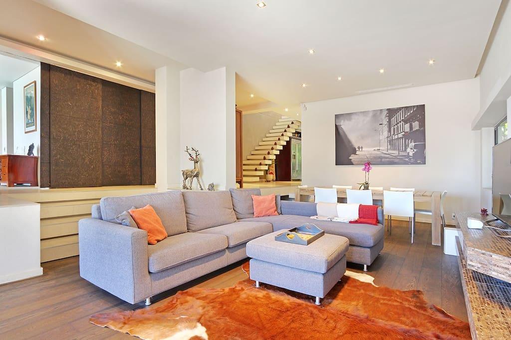 Spacious living room with oak floor.