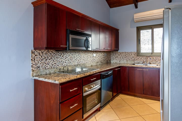 Stunning ocean views of two bays from this elegantly decorated unit in Flamingo