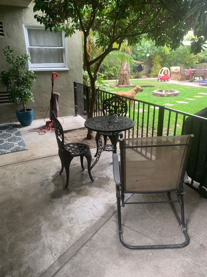 The patio! You can see my dog there in the background. You will most likely hear him bark, but he means no harm!